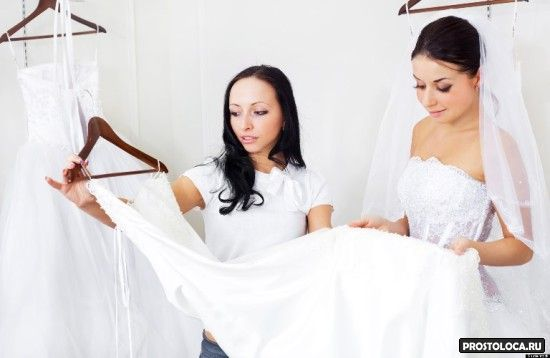 pretty young women  choosing  wedding dresses in the shop; Shutterstock ID 45087274; PO: The Huffington Post; Job: The Huffington Post; Client: The Huffington Post; Other: The Huffington Post