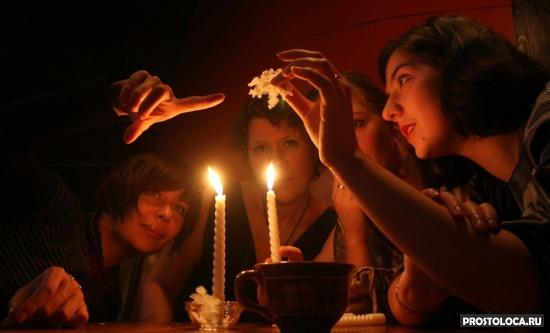 Image: Young women examine melted wax during a Russian Orthodox Christmas-tide party on the eve of Epiphany